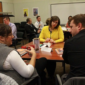 A group of school and district administrators work together